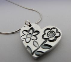 Chunky fine silver flower pendant.  Handmade at the Silvella Studio www.silvella.co.uk