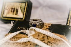 Holy Matrimony <3 Bible for ring 'pillow'.. made a cross out of burlap on the Bible with 2 ribbons.. <3