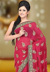 An occasion wear perfect is ready to rock you. This pink faux georgette saree have beautiful embroidery patch work which is embellished with zari, sequins, stone and cutdana work. This saree gives you a modern and different look in fabulous style. Matching blouse is available. Slight Color variations are possible due to differing screen and photograph resolutions.