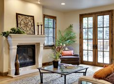 The New White -   Fresh Linen C13-4 -     A color scheme of tan and white is paired with classic furnishings for a traditionally styled living room. Orange accent pillows help to balance the mostly neutral room.