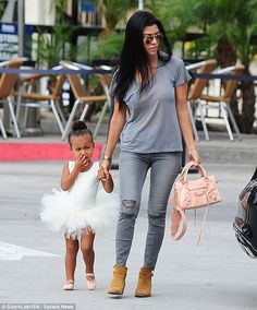 In the care of her aunt: North held onto Kourtney's hand while her mother Kim is with Khloe and Kris at the hospital