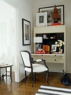 Tuck a secretary desk into a little-used corner of your living room for tons of extra storage!