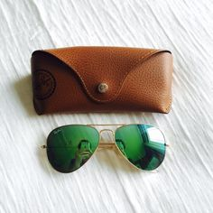 Green/Blue Ray Bans In great condition. Worn a few times. Comes with case Ray-Ban Accessories Sunglasses