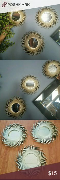 Set of 3 Gold Spiral Wall Mirrors Spiral gold mirrors measuring 10 inches are a great unique accent for your home.  Decorate your home in a lovely way before the holidays Other