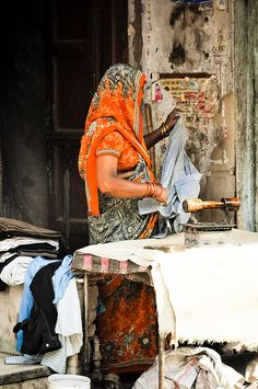 Presswali (woman ironer) India