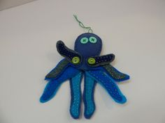 Handmade Felt Blue Octopus Ornament with Moveable Arms #Unbranded #AllOccasions Handmade Felt, Octopus, Wool Felt, Hand Sewing, Arms, Make It Yourself, Christmas Ornaments, Holiday Decor, Amazing