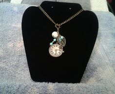 Turquoise and Antique Bronze Charm Necklace  by GlamGalsJewelryBox, $20.00