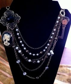 Steampunk Pirate Goth Baroque Necklace with white and black pirate's lady cameo and embellished antique skeleton key. $58