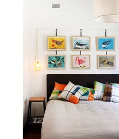 Stephen and Helena Trupp's Melbourne home, via The Design Files. Love the cage light and Charley Harper prints. Style At Home, Pictures Above Bed, Hang Pictures, Bedroom Art, Master Bedroom, Hanging Light Bulbs, Hanging Lamps, Picture Rail, Charley Harper