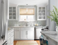 """Small Kitchen Design. Small kitchen with a smart layout. Countertop is Montclair Danby Marble. It's a natural stone. Wall paint color is """"Sherwin Williams SW6246 North Star"""". Backsplash tile is Sonoma Tilemakers Vihara Puka Silk 1"""" x 4"""". Small kitchen with smart layout. Small kitchen layout ideas #SmallKitchen #SmallKitchenDesign #SmallKitchensmartlayout #SmallKitchenlayoutideas #SmallKitchens Castle Design"""