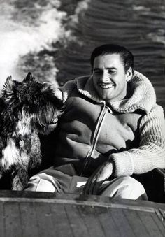 Errol Flynn and his dog Arno, 1939