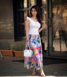 Bringing on the summer vibe with my favourite breezy vibrant floral skirt paired with a pristine white top! 💐 What do you think of my look? Beautiful Girl Indian, Beautiful Indian Actress, Fashion Tips For Women, Womens Fashion, Fashion Ideas, Ladies Fashion, Bad Fashion, Sleeveless Outfit, Stylish Girl