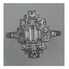 Art Deco Platinum Baguette and Single Cut Diamond Engagement Ring Circa Early 1900's