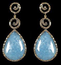 Aquamarine & Diamond Earrings. Accompanied by 31.94 carats of Aquamarine and 1.99 carats of Diamonds. Set in 14 karat Yellow Gold and Silver.
