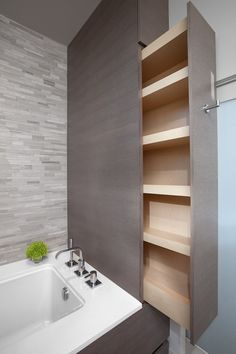 This is great! Hidden storage is always appealing. Any style could be worked for this and can be done at the tub as here in this picture, or in a small space in a bathroom. I can see it working similarly in a kitchen also.
