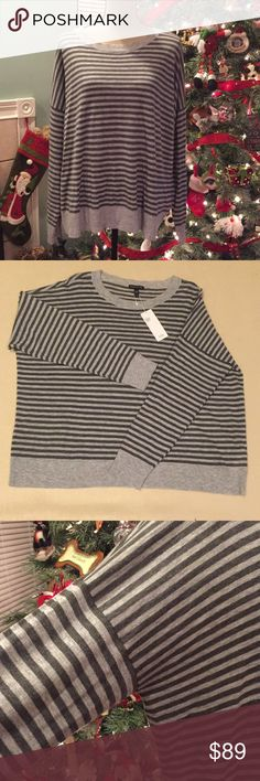 Eileen fisher striped sweater size L NWT Beautiful striped sweater from Eileen Fisher in shades of grey. 50% tencel, 30%wool and 20% alpaca. Hand wash or dry clean. Light weight and  super soft. Brand new with tags with no flaws or defects. Would make the perfect gift. Comes from smoke free home. Orig. $188. Eileen Fisher Sweaters Crew & Scoop Necks