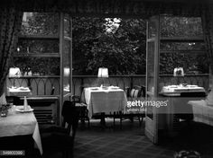 Germany Free State Prussia Berlin Berlin Guests in the Cafe Kranzler at the Kurfuerstendamm - view on the terrasse in the evening - 1938 - Photographer: Heinz von Perckhammer Vintage property of...