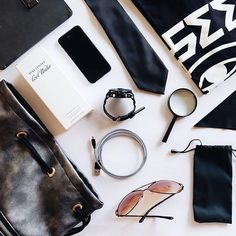 Thanks for sharing @itsfantasticjoren #whatsinmybag  #LeCord #charger #eero #blackandwhite #magnifyingglass #tie #watch #eyewear