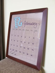 DIY: Dry Erase Calendar -- fabric (or scrapbook paper), frame w/glass (thrift store find?), sharpie for fabric or printer if using scrapbook paper. Alot cuter and cheaper than those plain white ones at Walmart!