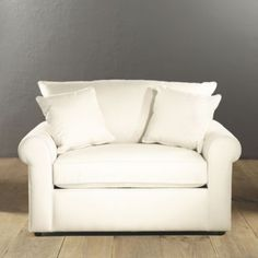Oversized chair that has a fold out twin bed. Would look great in a grey color to match the sectional.