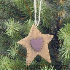 "Old World Stitched Star Ornament - 2 3/4"" high. Perfect primitive addition with a hand-stitched look! Hang in a pine branch wreath or tree for a country Christmas look. A jute loop is attached for hanging. #country prim decor #star and heart xmas tree decoration"