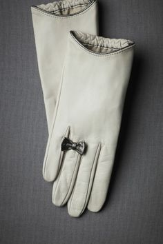 Gloves with bow.
