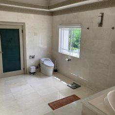 Marble tiled bathroom floor and walls.