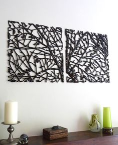 Fused and lustred black glass wall panels, 42cm square each.
