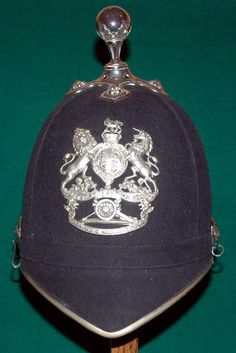 Home Service Helmet of the 1st. Cardigan R. Garrison Artillary Volunteers. White metal mounted, unit annotated helmet plate with Kings Crown. By Samuel Brothers, Naval and Military Outfitters, 65 & 67 Ludgate Hill, London.