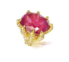A tourmaline and diamond ring, circa 1965  The large oval mixed-cut pink tourmaline gripped by eight talons, decorated with brilliant and single-cut diamonds, diamonds approximately 2.40 carats total, tourmaline approximately 32.0 carats, French assay mark.