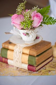 Best Ideas for Rustic Wedding Centerpieces Recycle the old and antique . Best Ideas for Rustic Wedding Centerpieces Recycle the old and antique books with tea cups by using them as a c. Vintage Book Centerpiece, Book Centerpieces, Centerpiece Ideas, Simple Centerpieces, Teapot Centerpiece, Centerpiece Flowers, Flowers Decoration, Spring Wedding Centerpieces, Summer Table Decorations