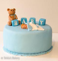 Baby shower cake with baby boy. #tekilasbakery http://www.tekila.fi/baby-shower-taytekakku-2/