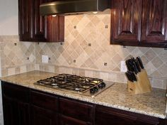 tile backsplash with giallo ornamental granite countertops | DFW Granite:  Gallery 261 photos Get a