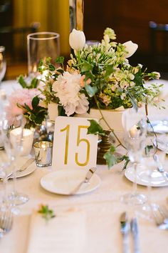 gold table number, photo by Redfield Photography http://ruffledblog.com/romantic-philadelphia-wedding #weddingideas #tablenumbers #centerpieces