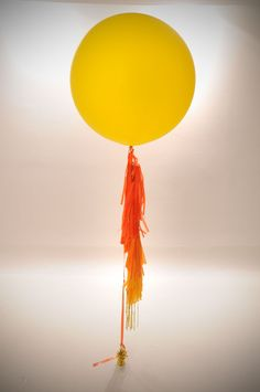 Sunburst yellow gold orange Custom Creation Big Round Balloon Tassel Garland. $30.00, via Etsy.