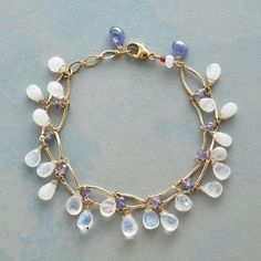 MOONSTONE METAMORPHOSIS BRACELET--As though freshly emerged from tanzanite cocoons, moonstones exude their new-life iridescence. Linked strands of 14kt gold filled arcs