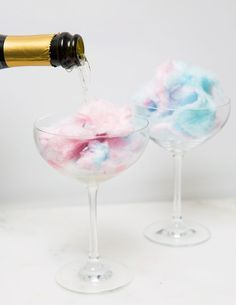 COTTON CANDY CHAMPAGNE DRINKS: http://Cosmopolitan.com rounded up the best ways to make fun and festive champagne cocktails for your New Year's Eve celebrations. Here you'll find clever new ways to enjoy the bubbly drink, like this cotton candy drink hack. Click through for more easy champagne and cocktail ideas and recipes you need to try!