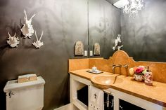 Half bath, stag horns, stamped concrete sink, chandelier   1080 Drake Street, Montara, CA 94037 - PlanOmatic.com