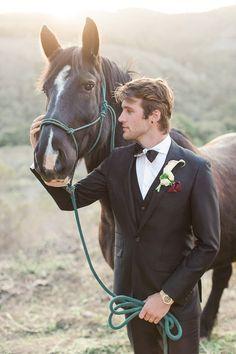 Groom with a Black Three Piece Suit  and a Horse | Carlie Statsky Photography on @heyweddinglady via @aislesociety