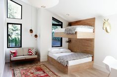 Built-in twin bunks in a kids' room by interior designer Lisa Staton and builders Lochwood-Lozier, photo by Belathée | Remodelista