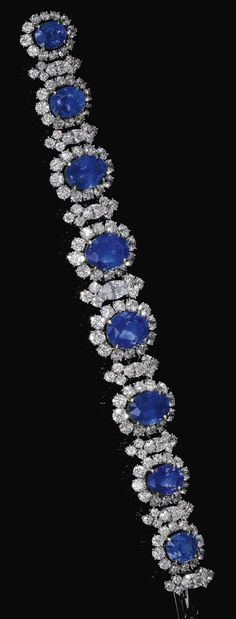 SAPPHIRE AND DIAMOND BRACELET, BULGARI, CIRCA 1965. Designed as a graduated line of oval sapphires framed with brilliant-cut and marquise-shaped diamonds, length approximately 180mm, signed Bulgari, case stamped Bulgari.