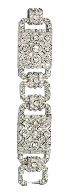 DIAMOND BRACELET, 1930S. The wide band composed of pierced geometric plaques millegrain-set with circular- and single-cut diamonds, length approximately 180mm.