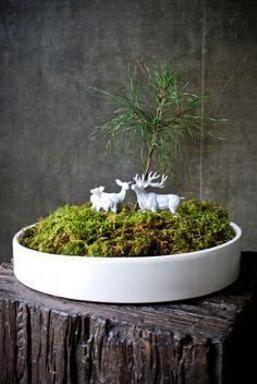 open air terrarium with white figurines