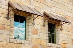 Window awnings keep out the sun and heat, making your home more energy efficient!  www.ashcreekhomes.com