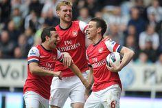 Arsenal Laurent Koscielny (right) celebrates scoring the opening goal