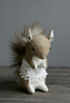 busy squirrel: a small squirrel with a vintage apron for wiping acorn crumbs on.    hand stitched from vintage camelhair, stuffed with lambswool and finished with a salvaged fur tail.