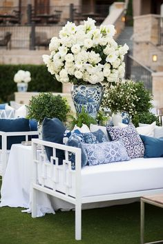 Malibu Day Beds from www.perchdecor.com piled sky-high with blue and white pillows + the prettiest blooms from Jackson Durham | photo: Sarah Kate, Photographer