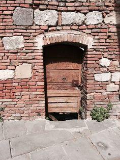 Wooden door in Montepulciano Italy.