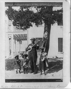 Blind Musician,African American man with a banjo,Children playing percussions