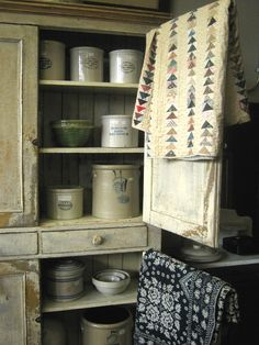 cupboard, crocks, quilts...